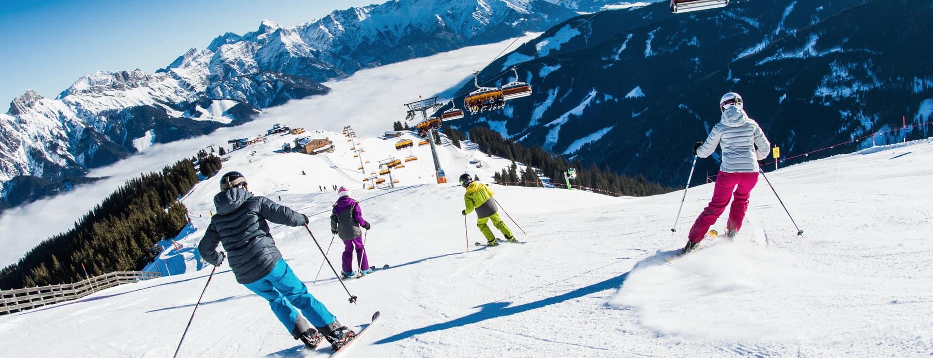 Alpin skidåkning familj skidsemester härliga backar Saalfelden Leogang Fieberbrunn skicircus